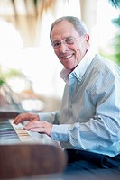 Older man playing piano