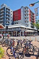 Australia, Northern Territory, Darwin, bicycle parking at Smith Street mall with view of Central Hotel at the intersection of Smith and Knuckey Street...