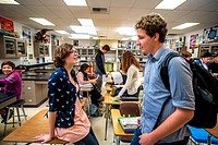 Advanced placerment (AP) high school chemistry students talk before class and check their graded papers in San Clemente, CA