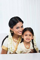 South Indian woman smiling with her daughter
