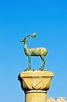 Elafos, sculpture of a deer on a column at the harbour entrance of Rhodes, Mandraki harbour