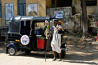 Hindu Man In Traditional Clothes Outside Rickshaw In Belur, Karnataka, India