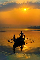 FISHERMAN ply the waters of Taungthaman Lake at sunrise, Burma, Amarapura