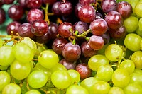 Close Up Of Several Green And Red Grapes.