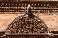 Kathmandu, Nepal. Wood Carving above a Door in the Kumari Bahal, House of the Kumari Devi, a Young Girl Revered as a Living Goddess. The wood used is ...