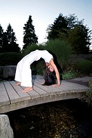 Woman doing yoga - Chakrasana wheel