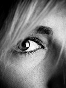 Close up of the eye of a young attractive caucasian woman, black and white.