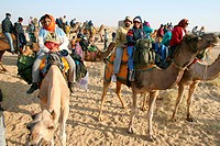 Camel ride at Sam Thar desert safari sand dunes , Jaisalmer , Rajasthan , India