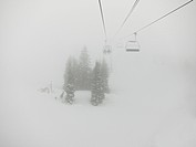 Ski lifts in the fog, California, USA