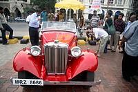 Vintage Red car  ; Kala Ghoda ; Bombay Mumbai ; Maharashtra ; India