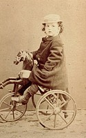 Claude Debussy (Saint-Germain-en-Laye, 1862-Paris, 1918), French composer and pianist, seen here as a child on a tricycle, April 15, 1867.  Saint-Germ...
