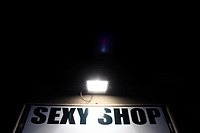 sexy shop sign at night in rome italy.