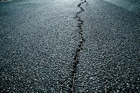 Germany, North Rhine Westphalia, Duesseldorf, Asphalt cracks on road