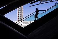Man getting down the stairs at Gare do Oriente. Lisbon, Portugal.