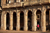 dilapidated facades and columns of Malecon in Havana, Cuba, Caribbean.