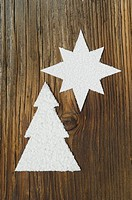 Carved christmas tree and star on wooden board