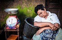 Woman having a nap waiting for clients, Carbon market, Cebu, Philippines, South East Asia.