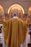 Priest during Eucharist celebration, Paris, France, Europe