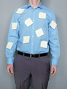 Businessman with adhesive note shirt