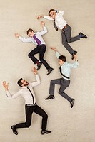 Businessman and boys flying in office