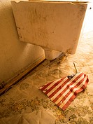 American flag on mattress next to a toilet inside a foreclosed house in Phoenix, Arizona, United States.