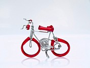 A red miniature bike handicraft model from Thailand.