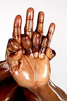 Folded hands of a black bodybuilder ( color photo ) in front of white background. - 15/07/2004