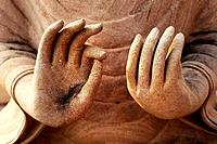 Details of a Buddha statue's hands in a temple in a village near Battambang, Cambodia.