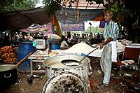 Man making rice food for the supporters of anna hazare ramlila maidan in new delhi India Asia