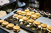Traditional sweet red bean and cream cakes being made on a iron skillet mold in Taipei, Taiwan.
