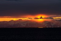 A Colourful Sunset Below A Cloud Bank Over The Chugach Mountains Turns Into A Surreal Golden Glow During Low Tide On The Copper River Flats Salmon Fis...