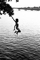 Leaping boy, Huong River, Hue, Vietnam.