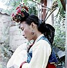 A Korean woman in traditional dress, North Korea, 1962. Such attire would have been worn by a servant girl or entertainer working at a palace.