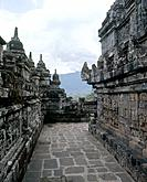 Borobudur. A view of the terraces . The many Buddha figures set in the walls symbolize projections of the single Buddha-nature. Country of Origin: Ind...