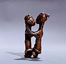 A gold weight representing a man and woman during sexual intercourse. Country of Origin: Ghana. Culture: Ashanti. Material Size: Brass. Credit Line: W...