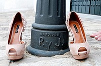 female shoes with a lamppost.