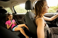 Mom and daughter into a car.
