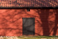 Outdoor shed with black door