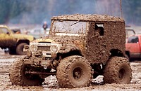 Truck Driving Through Mud