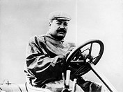 Vincenzo Lancia at the wheel of a car. The Son of an Italian soup manufacturer, Lancia began his career as Fiat's chief test driver. In 1904 he won th...