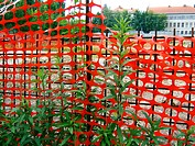 Red fence with green plants