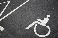 Germany, North Rhine Westphalia, pictogram of disabled parking space on asphalt
