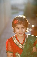 Portrait of an indian american girl playing outdoors.