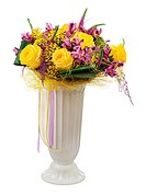 Floral bouquet of yellow roses and orchids arrangement centerpiece in vase isolated on white background. Closeup.