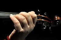 Close up of man playing violin.