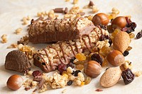 Chocolate and muesli bars with mixed nuts and cereals.