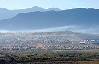 An aerial of part of Clanwilliam with mountains in the background