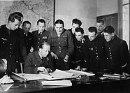 A group of aviators, both French and British, study the plan of operations
