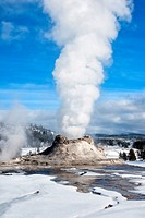 Castle Geyser erupting on a winter day at Yellowstone National Park, Wyoming, USA.