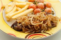 Onions with steak and chips